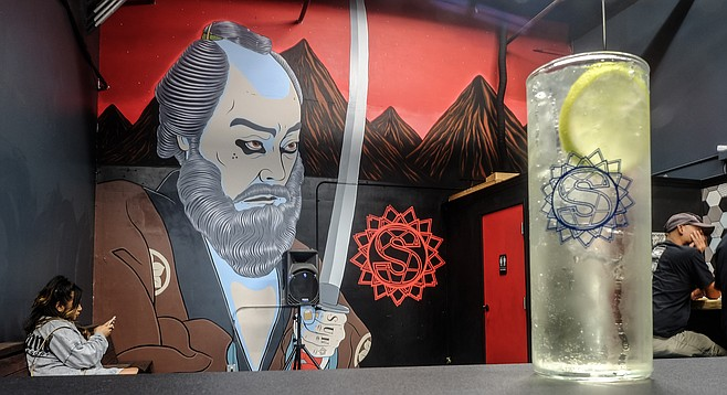 Sake and tonic, and a Ronin mural by artist Mike Maxwell in the new Setting Sun Sake tasting room.