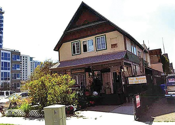 A massage parlor was located at the old Victorian house that was torn down to build the micro apartments.