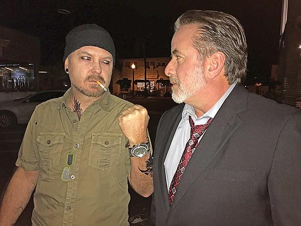 Heavy negotiating: do we have a deal? Zeke (Randy Davison), Trent Williams (Mark Anthony Cox)