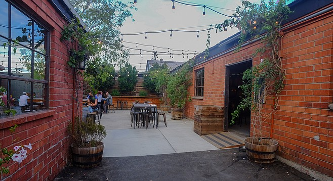 The entrance to Sourworx, and the courtyard it shares with Helix Brewing Co.