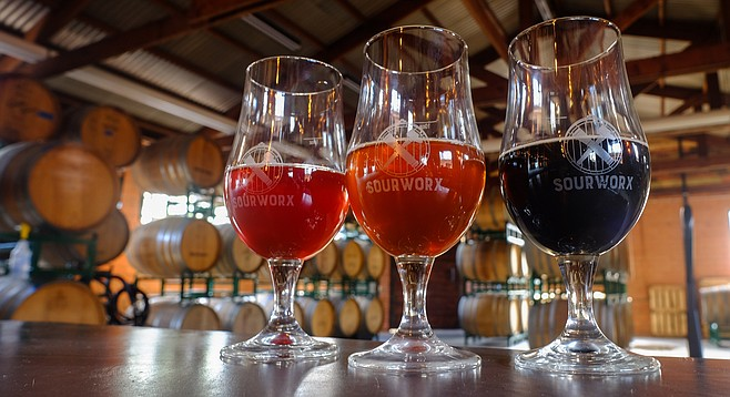A red, golden (orange), and dark sour at Helix Brewing's new tasting room, Sourworx