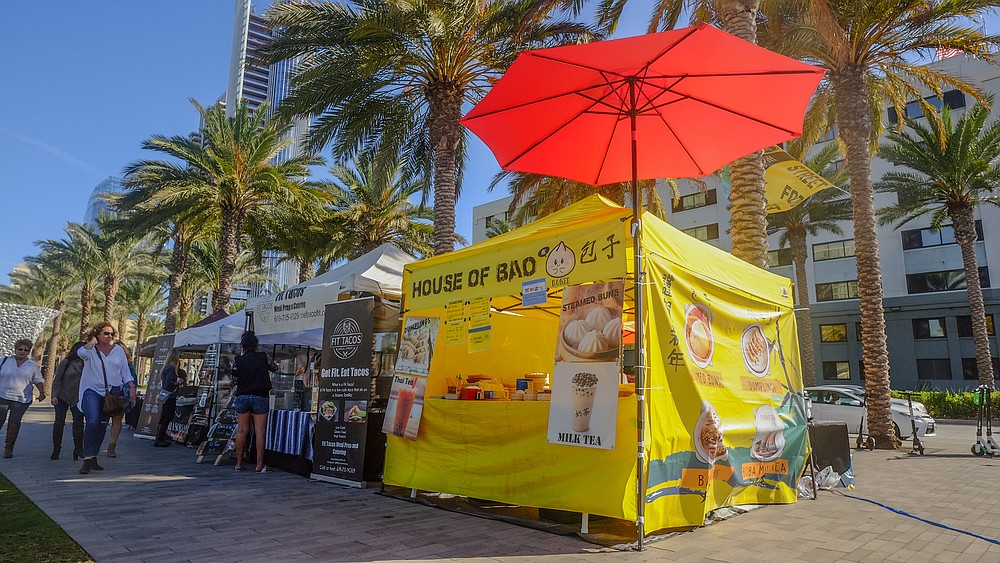 House of Bao joins other food vendors serving food beneath palm trees along Broadway