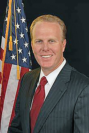 Nobody knows why Kevin Faulconer is still smiling.