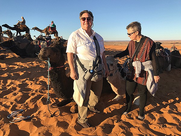 Teri Siciliani (left) — here on vacation in Morocco — is frustrated with the bureaucratic process required to remove homeless encampments from her canyon property.