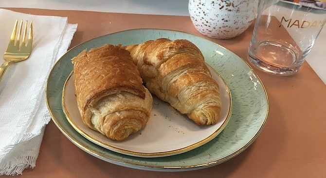 Patisserie Melanie specializes in French pastries, specifically croissants. Chocolate, left, butter croissant, right.