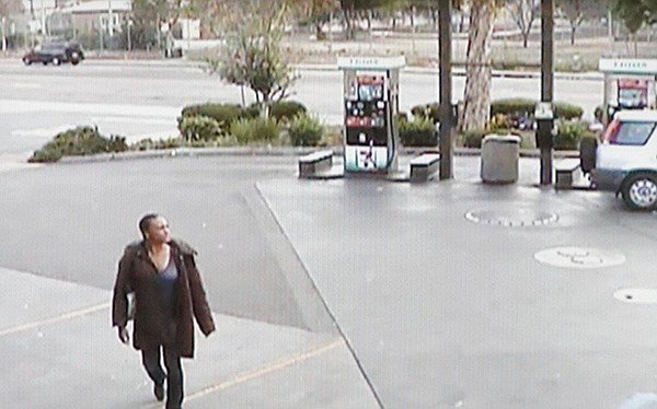 Surveillance video: Asiatae wore a long coat as she walked to corner stores that morning