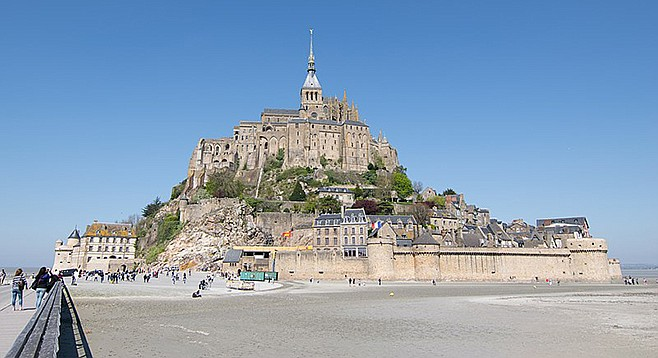 Make a virtual visit to Normandy to learn about famous historical sites, such as Mont-Saint-Michel (pictured above)