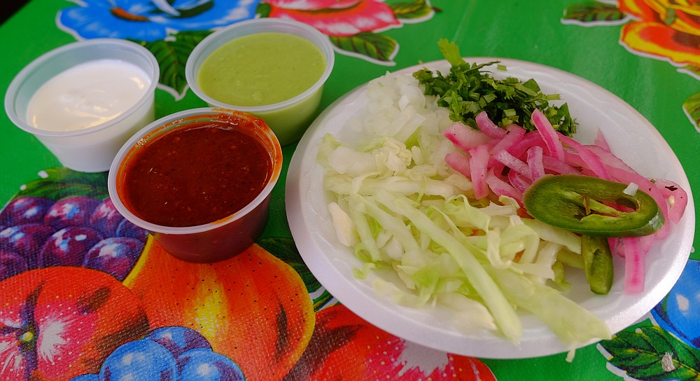 Gorditas Don Andres has a well equipped salsa bar and colorful tablecloths.