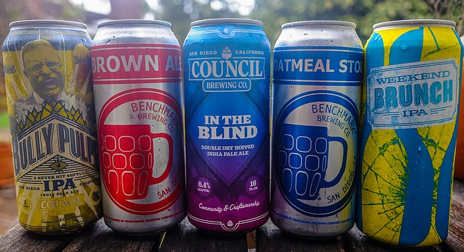 Cans from Council Brewing and Benchmark Brewing