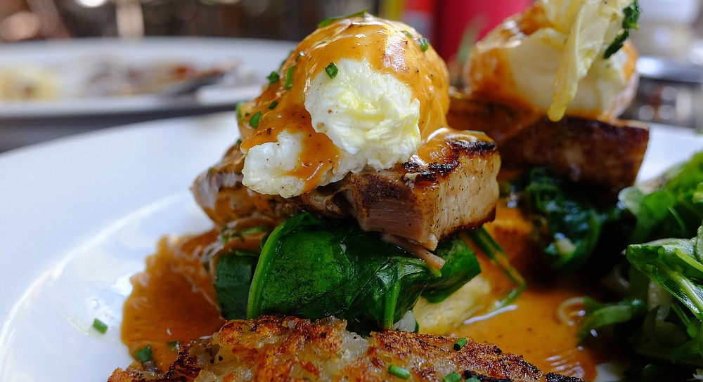 Pork belly, spinach, and poached egg, drenched in ancho chili hollandaise, over a cheddar and chive biscuit