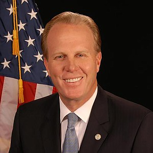 Kevin Faulconer is smiling because he thinks the state is going to pay to fix the city's homeless problem.
