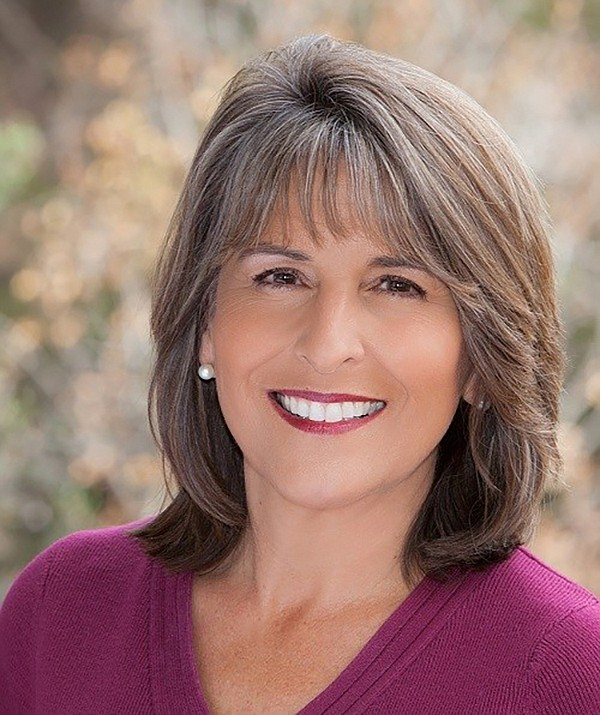 Lorie Zapf is smiling, despite losing her her council seat, because her daughter  retainined her job with a city hall lobbying firm.
