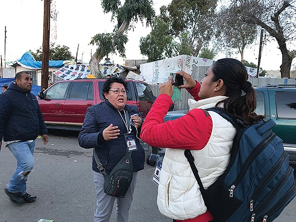 Susana Solis reports to Chiapas. Patricia Espinosa videos on her iPhone.