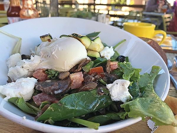 My Breakfast Salad. Eggs are the key, but the white chèvre goat cheese gives the flavor.