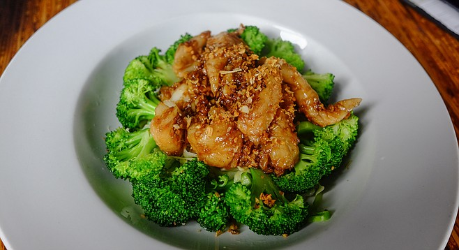 Steamed sole and broccoli quickly stir fried with garlic and pepper