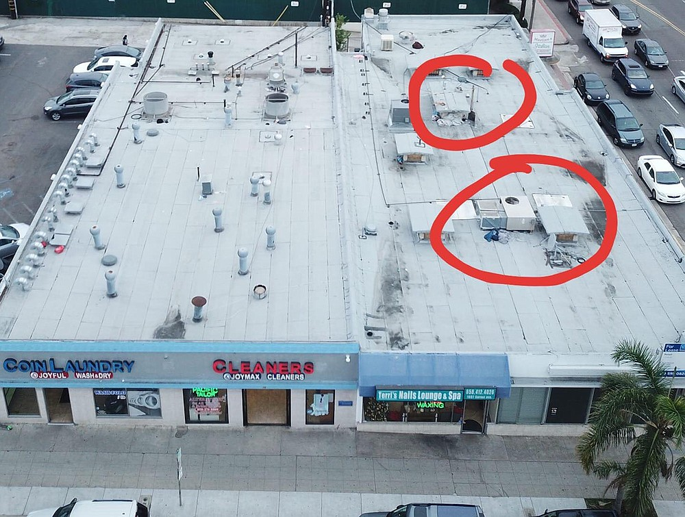 "Vacant Garnet building. ""We found stashed belongings – but no people – on top of another building by using the drone."""