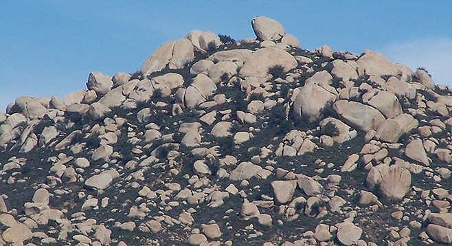 Erosion has exposed a rocky summit