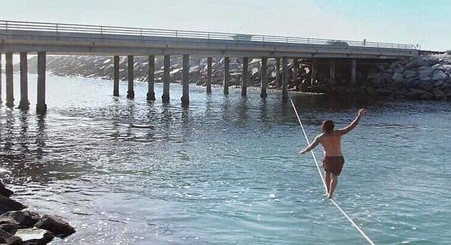 150-foot webbing affixed to Carlsbad Boulevard bridge support columns.
