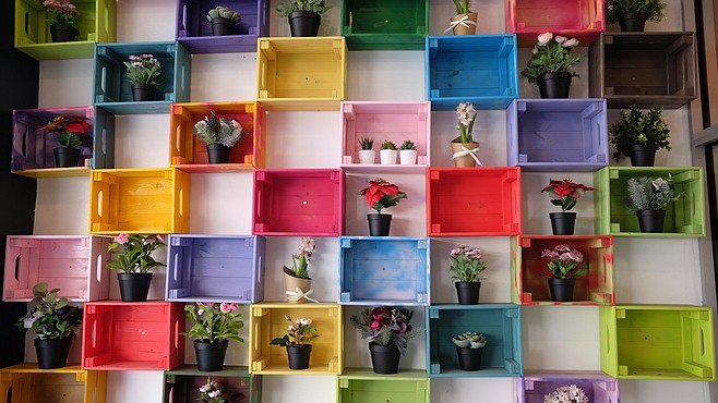 One patio wall is decorated with colorful planters.