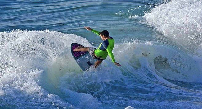 When the swells are good, Young performs body varials.