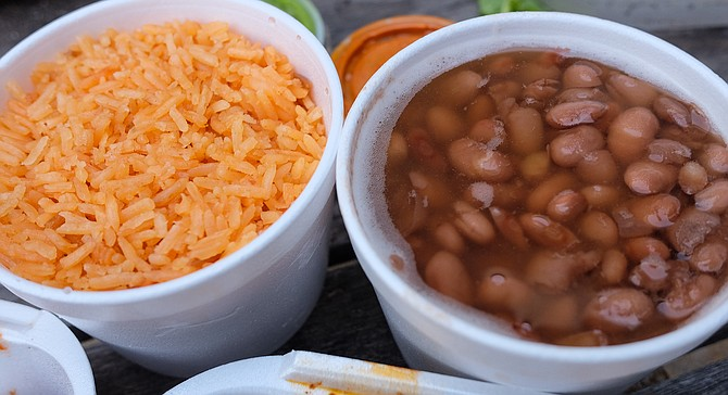 Tubs of beans and rice complete the Acapulco BBQ meal.