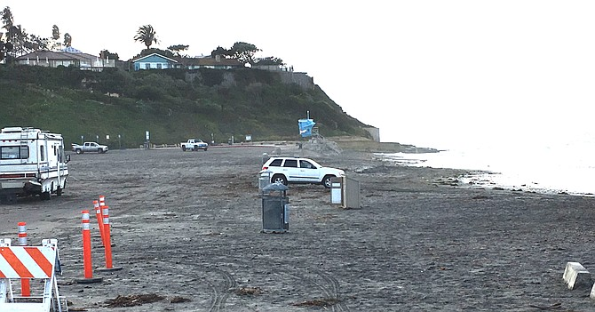Christmas Day Seaside Beach in Cardiff by the Sea suffered sand and rock damage over one half of the low-lying parking lot.