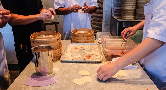 See dumplings made by hand while waiting for your table.