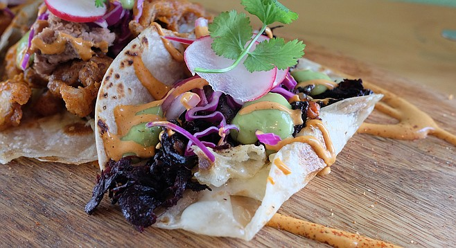 Hibiscus flower tops the list of veggies on this taco.