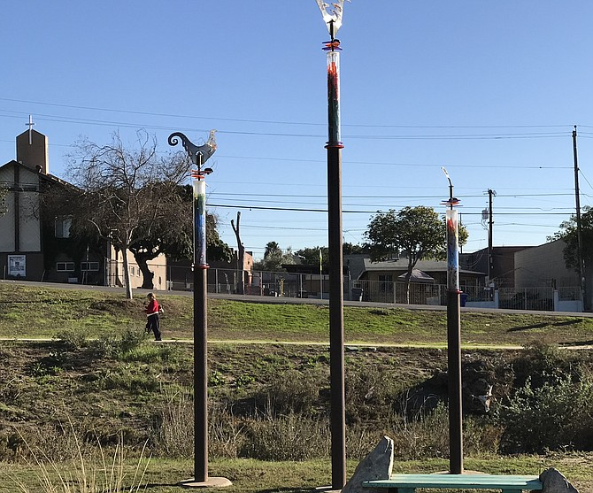 The poles beckon visitors into the park.