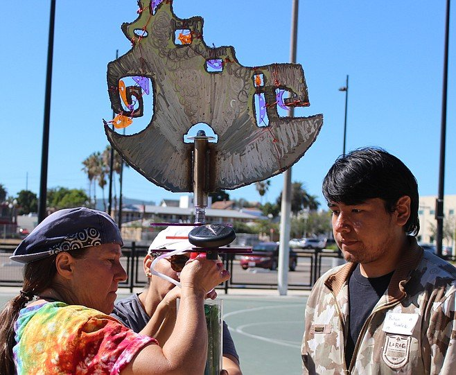 Vicki Leon (left) designed the totems, similar to those that mark the gateway to Azalea Park in City Heights.