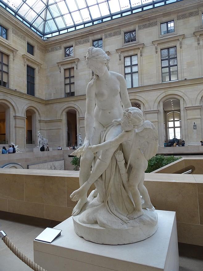Venus teaching Cupid to use his bow.