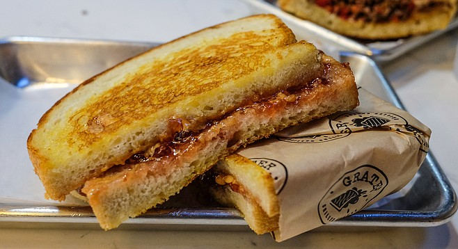 This grilled peanut butter and jelly would be better on whole wheat, not sourdough.
