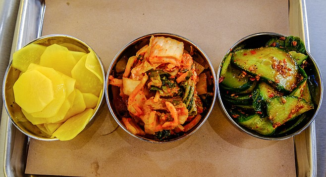 Banchan: turmeric pickled diakon radish, Napa cabbage kimchi, and sichuan cucumber