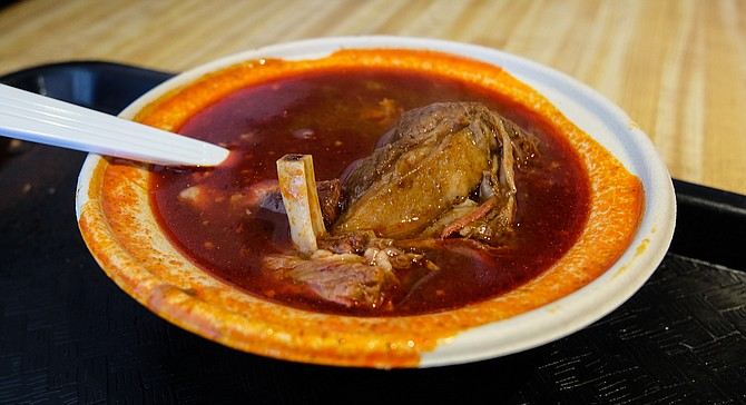 Goat meat and bones meet chili peppers in the warming Birria de Chevo soup.