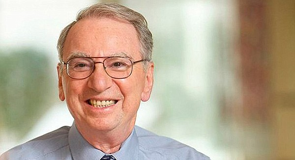 Irwin Jacobs is smiling because he has enough money to influence Republicans and Democrats alike.