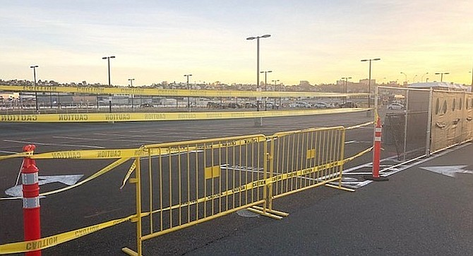 Yellow tape at Uber lot