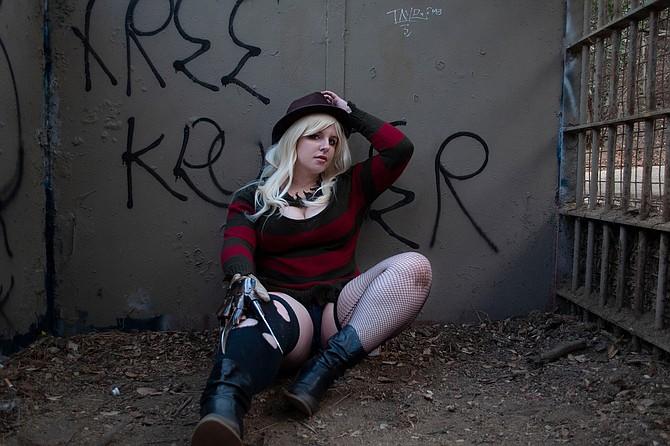 Nikki cosplays as a sexy version of Freddy Krueger