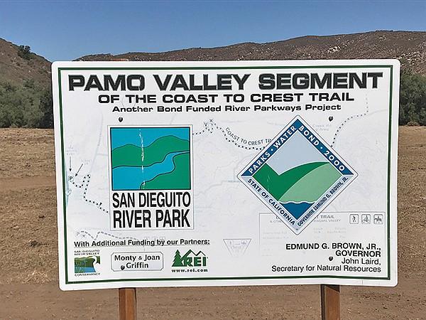 Sign announces new trail segment