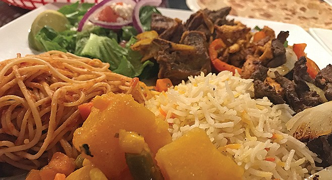 Potatoes, pasta, basmati rice, and salad surround the goat, beef and chicken suucqar