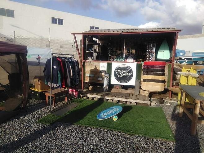 """Left Playa Hermosa Surf & Skate Shop and grabbed his nine foot 'thruster'."""