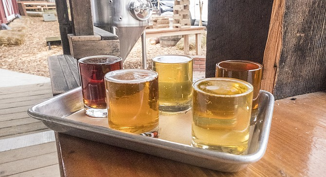The colors in a flight of beer seem autumnal when drinking in the mountains.