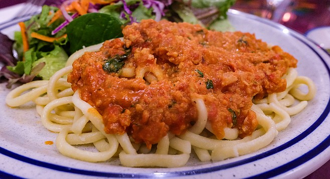 Tallarines Vatapa: noodles topped by a Brazilian sauce of peanuts, coconut, ginger, and spice