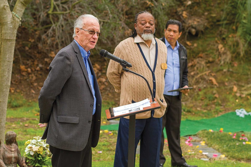 Allan Musterer speaks during the ceremony at the Garden of Innocence