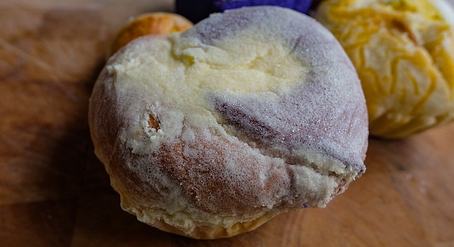 An ensaymada is a Filipino pastry similar to a danish.