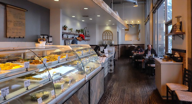 A counter full of pastries and side dishes