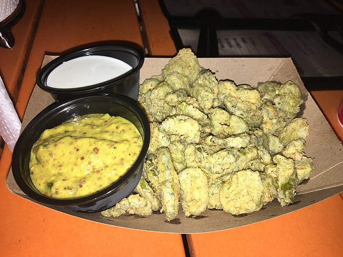 Lil Piggy's fried pickles come with both ranch dressing and a mustard sauce for dipping.