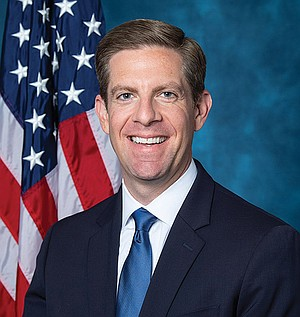 Mike Levin is smiling because the freshman congressman is already enjoying lobbyist-funded free travel.