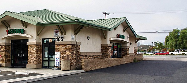 There is a 7-ELEVEN across the street from the park in San Marcos