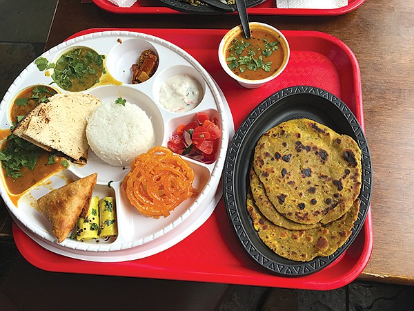 """Our thali plate: Three """"curries"""" on left, yellow khanvi front center, orange jalebi on right"""