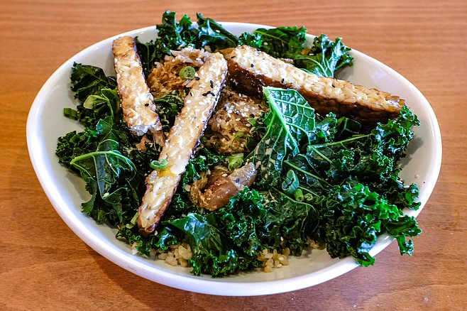 Steamed kale, Torfurky tempeh, and sauerkraut over brown rice